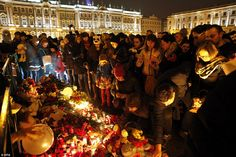 Dozens of Russians gathered in front of a memorial paying tribute to the victims who were on board the jet when it came down over Sinai