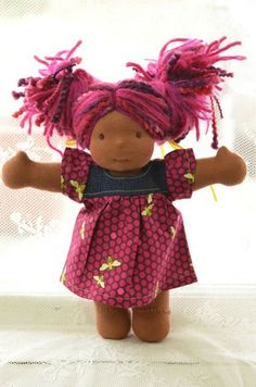 Bamboletta — Little Buddy - Wren January 24, 2014 This is Wren. She has dark skin, long hair made with mohair and wool yarns in a dark pink color with variegated lilac and deep pink wool spiral yarns and brown eyes. She is wearing the pictured outfit and underpants.