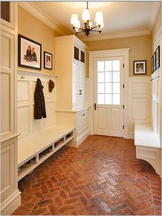 I feel as if I've pinned this mudroom before. I love this brick floor. Another nice door too.