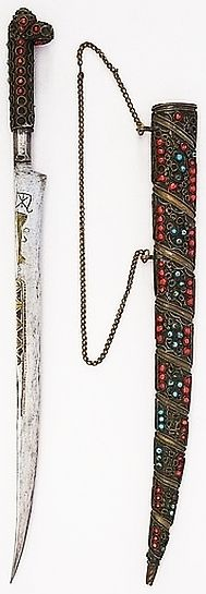 North African flyssa dagger, 18th to 19th century, brass, glass, H. with sheath 16 3/16 in. (42.7 cm); H. without sheath 15 1/4 in. (38.7 cm); W. 1 5/16 in. (3.3 cm); Wt. 5.8 oz. (164.4 g); Wt. of sheath 5 oz. (141.7 g), Met Museum.