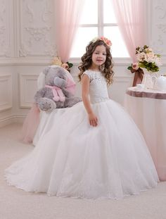 Beautiful white or ivory flower girl dress with multilayered skirt, corset with applique and rhinestones, zipper and lacing  Item material: