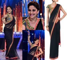 GET THIS LOOK: No one wears the sari better than the 90's diva Madhuri Dixit - Nene, here seen in the black sari with the mirror work blouse by Arpita Mehta.  Shop the sari at http://www.perniaspopupshop.com/arpita-mehta-27 — with Somya Gupta.