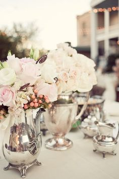 flowers in silver teapots as tabletop décor....awesome idea for a bridal kitchen tea