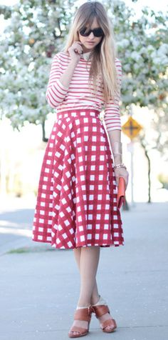 One way to style a midi skirt: tucked-in long sleeve shirt.  Do a graphic shirt to add drama/edge?