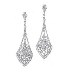 "These bridal Earrings are what make vintage wedding jewelry so popular! They boast a jewel-encrusted flare design rich in cubic zirconia inlaid stones. These dramatic silver rhodium plated Earrings measure 2 3/4"" for an eye-catching wedding accessory. These antique style Earrings have a coordinating necklace 1072N. They are also available in gold."