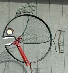 Art - fish from bike wheel rim. This page has a couple of other art ideas.