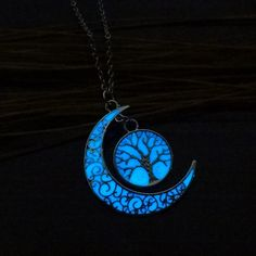Silver Plated Tree of Life Crescent Glow In The Dark Necklace    https://zenyogahub.com/collections/jewellery/products/silver-plated-tree-of-life-crescent-glow-in-the-dark-necklace