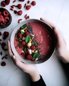 vanilla & raspberry smoothie bowl for breakfast!  simply blend 1 frozen banana, 1 cup frozen raspberries, 1 tsp vanilla powder & 1 cup almond milk... top with granola, chia seeds, fresh raspberries & mint! happy weekend all!
