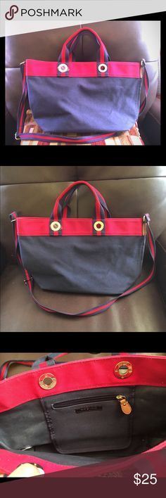 Tommy Hilfiger handbag/ cross-body Beautiful Tommy Hilfiger bag. Can be used as a hand bag or crossbody. Barely used. Great condition. Colors are Navy blue and red. Tommy Hilfiger Bags Crossbody Bags