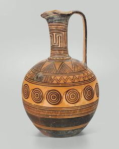 Pitcher (oinochoe).Dated 740–730 B.C. Dimensions Height: 33.1 cm (13 1/16 in.) Medium Ceramic Collections The Ancient World Classifications Vessels Culture Greek Place of Manufacture Boiotia, Greece Period Late Geometric Period