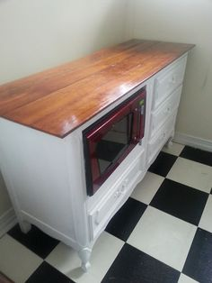 RePurpose: dresser into kitchen island. Great way to use space. Great place for the microwave.
