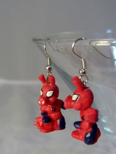 One pair of Spider Ham earrings with silver hooks. Each measures 1.75inches or 4.5 cm from the top of the hook to the base, .75 inches or 1.5