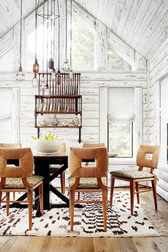 Painted wood walls and ceiling in cabin with rustic and industrial dining space