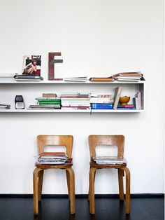 • interiors / mid century love love this combo of white walls, bentwood chiars and stacks of books.  simple and refined.
