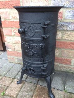 Salgotarjan Pot Belly Stove Black cast Cooking Workshop Stove Fire Log Burner Small Fireplace, Stove Fireplace, Antique Wood Stove, How To Antique Wood, Coal Stove, Corrugated Tin, Wood Stoves, Up In Smoke