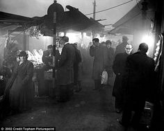 Dirty: Residents walking around London, such as to a local market pictured above, during the smog reported being left filthy from simply walking through the streets