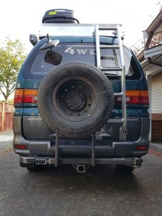 Mitsubishi Delica L400 trailer hitch and spare tire rack.