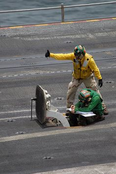 File:US Navy 090801-N-9132C-064 Aviation Boatswain's Mate (Equipment) 3rd Class James Deguise makes sure the catapult is ready to launch an aircraft off of the flight deck of the aircraft carrier USS Ronald Reagan (CVN 76).jpg - Wikimedia Commons