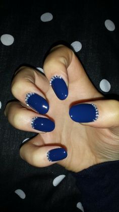 Oval nails with barry m gelly polish and gems.
