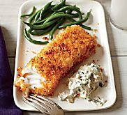 Parmesan, mayonnaise and breadcrumbs may seen an unlikely pairing for fish, but they create a flavor-packed crust that helps keep the fish deliciously moist while it bakes. Goes well with sautéed spinach! Tilapia, catfish, whitefish, striped bass, haddock or scrod are good choices for the fish. Also works well with chicken.