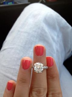 3 carat colorless, cushion cut center stone, 3 sided micro pave diamond band..... perfect.