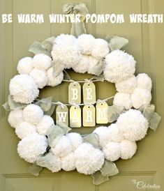 Make a big, fluffy Be Warm Winter Pompom Wreath to welcome family and friends during the cold & frosty winter months!  #crafts #winter