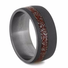 Here is a more masculine version of my signature stardust ring. This mens titanium wedding band has a sandblasted exterior for that rugged, charcoal look...