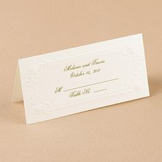 Embossed scrolls and roses create a lovely border for these soft white place cards.