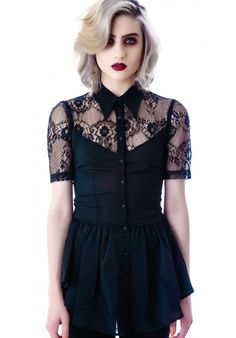 Lip Service Black Steam Lace Cap Sleeve Top shows some skin with lots of sikk lace on the capped sleeves and along the neckline.