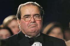 US Supreme Court Justice Antonin Scalia listens as US President George W. Bush speaks at the the Federalist Society's 25th Anniversary Gala Dinner at Union Station in Washington, DC 15 November 2007. AFP PHOTO/SAUL LOEB (Photo credit should read SAUL LOEB/AFP/Getty Images)