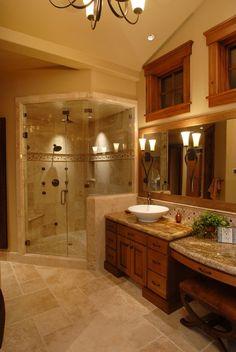 Craftsman Master Bathroom with Chandelier, Ceramic Tile, Framed Partial Panel, frameless showerdoor, can lights, Vanity