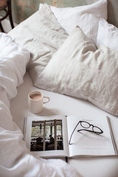 Old stripped bare plaster walls and white stonewashed linen bedding + instructions for how to properly care for linen bedding so it lasts for generations. Coffee In Bed, Coffee And Books, Home Staging, Messy Bed, Bed Photos, Plaster Walls, Breakfast In Bed, Slow Living, Bed Styling
