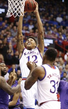Kansas guard Kelly Oubre Jr. (12) comes up for a dunk against Kansas State during the first half on Saturday, Jan. 31, 2015 at Allen Fieldhouse.