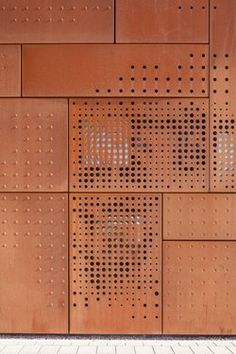 Perforated steel Studio Farris adds Corten udio Farris adds Corten extension to a library in Bruges Metal Building Homes, Building Facade, Facade Design, Wall Design, Metal Cladding, Weathering Steel, City Library, Perforated Metal, Perforated Plate