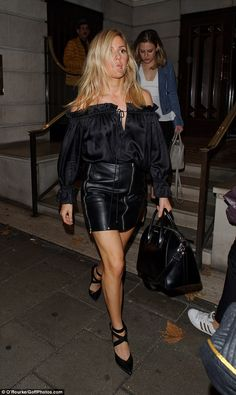 Blonde beauty: Ellie turned heads in a silky bardot top paired with a leather zip-up mini skirt as she hit the town after her gig at One Marylebone