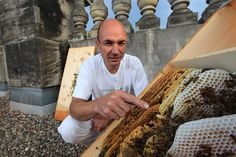 Heinz Risse, 48 years old, on the roof of the parliament of Berlin with his bee hives.