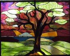 "Sunset Tree. Lovely.   ~This panel was commisioned for a retirement gift to an employee. The employee picked all the glass herself and it is hanging in her ""sitting room"" for her to enjoy."