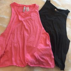 """2 for 1 •H&M Crop Top Bundle• 2 very cute """"muscle tee"""" style crop stops by H&M Divided. One neon pink and one charcoal gray. 60% cotton 50% polyester. Pre-loved but still good condition! Last 2 pictures show minor wear/tear on underarm area of each top, just on one side. H&M Tops Crop Tops"""