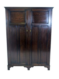 Circa 1922, by Harrods of Manchester, this beautiful wardrobe will be every gentleman's relish. A place for everything, and everything in it's place!  Timeless Classic from www.resourcevintage.co.uk