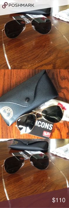 Ray ban gold/green aviators Worn twice, like new aviators. Comes with original case and cloth unopened. Perfect for smaller faces size 55. Ray-Ban Accessories Sunglasses
