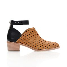 Loeffler Randall. Franca Cut-Out Bootie. Camel dot printed on haircalf. Black aviator calf leather. Back zipper. Stacked heel. Welted leather sole.