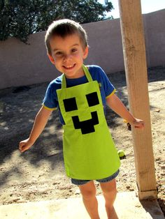 Order yours!  And ones for your nephews, grandsons, tomboys, nerdy hubbys...  Minecraft Inspired Boys Play Apron by DebbieDoesThat on Etsy, $15.00