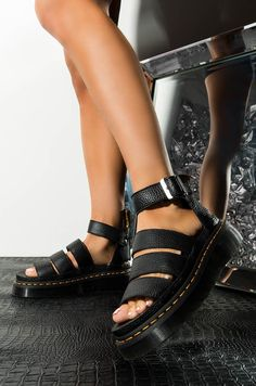 The DR.MARTENS Women's Clarissa II Quad Chunky Sandal in Black are a textured twist on the brand's signature sandal, complete with a tumbled leather upper, strappy design with a statement D-ring buckle fasten, cushioned footbed, stitched Dr. Martens, Dr Martens Damen, Sock Shoes, Cute Shoes, Me Too Shoes, Dream Shoes, Crazy Shoes, Timberland Boots, Style Pastel