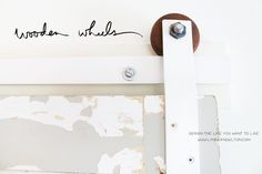 Make your own door track hardware & use handmade wooden wheels. For sale on the blog.