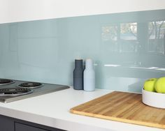 How sleek and stunning is this acrylic backsplash from fogmodern?! More budget-friendly than glass, it's also customizable, as you paint the inside of the acrylic so the outside retains its shiny finish. Stunning!