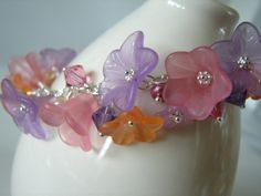 Lucite+Flower+Charm+Bracelet+Rose+Pink+and+Purple+on+by+Oogle,+$55.00