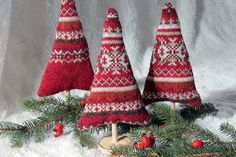 "Deck your halls in style and create some not-so-traditional ""sweater trees"" from outgrown layers. These are perfect for your mantelpiece!"