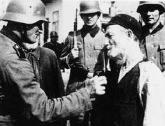 "A German soldier cuts the beard of an Elderly Polish Jew while his comrades look on.  The ritual abuse and degradation of Jews was one of the methods the Nazis used to dehumanize their captives, making slaughtering them of no more consequence than killing an animal.  Considered ""Untermenschen"" or sub-human, the Jews were, in fact, treated far, far, worse than even the lowliest beast. Note the sadness of the Jew, and the smirk of the abusive soldier."