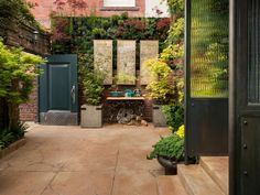 This courtyard garden at the San Francisco Decorator Showcase 2013 is filled with lush plants to create a garden oasis.