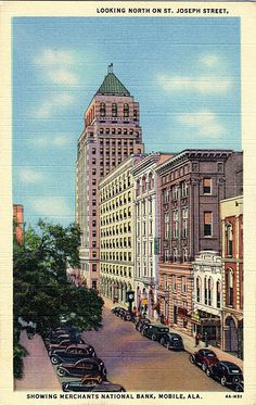 Vintage Alabama postcard of looking north on St. Joseph Street and showing the Merchants National Bank in Mobile.